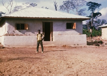 Mamadee Wattee stands in front of his home in Gbarnga Liberia in 1967. Later Mamadee would become an elementary school principal in New Jersey.