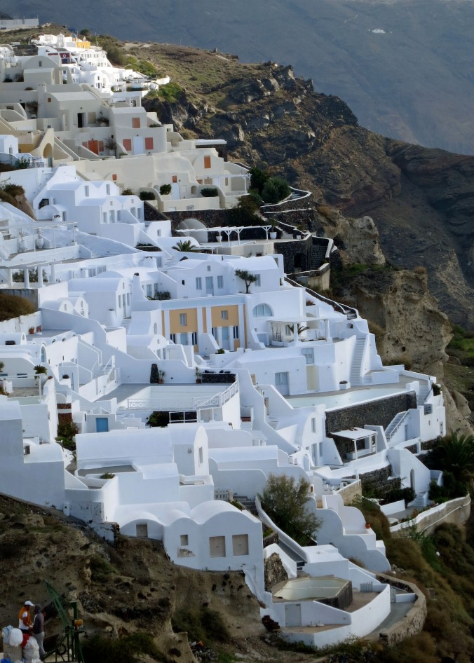 Another view of the town that provides a perspective on how it clings to the cliff. The whitewashed buildings reflect heat from the intense summer sun.