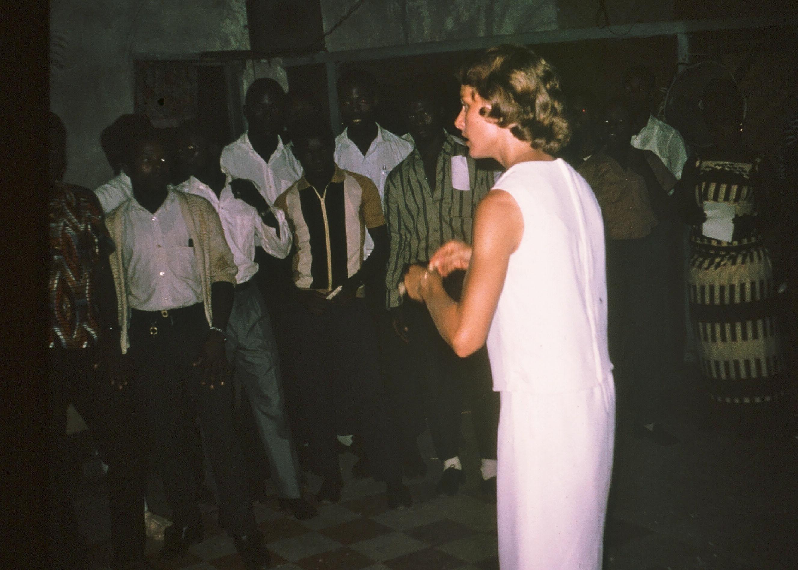 Jo Ann directing her Gboveh High School chorus. At Berkeley, she had belonged to the University's elite Glee Club.