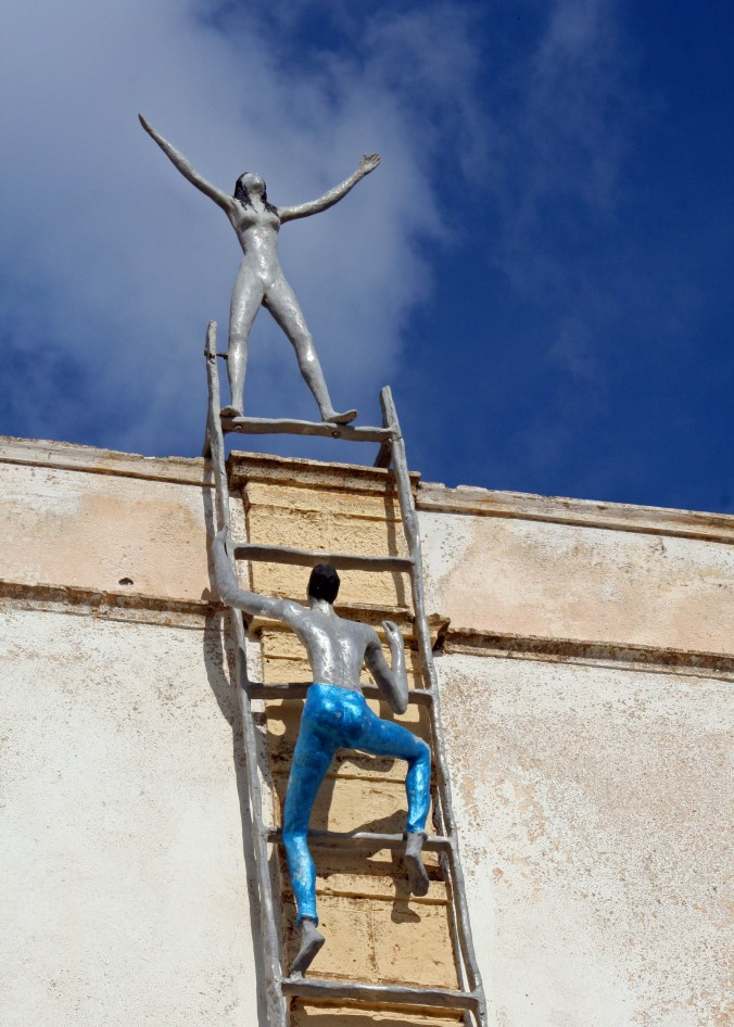 Peggy discovered this sculpture on the side of a building in Oia. Everyone should have a goal in life.