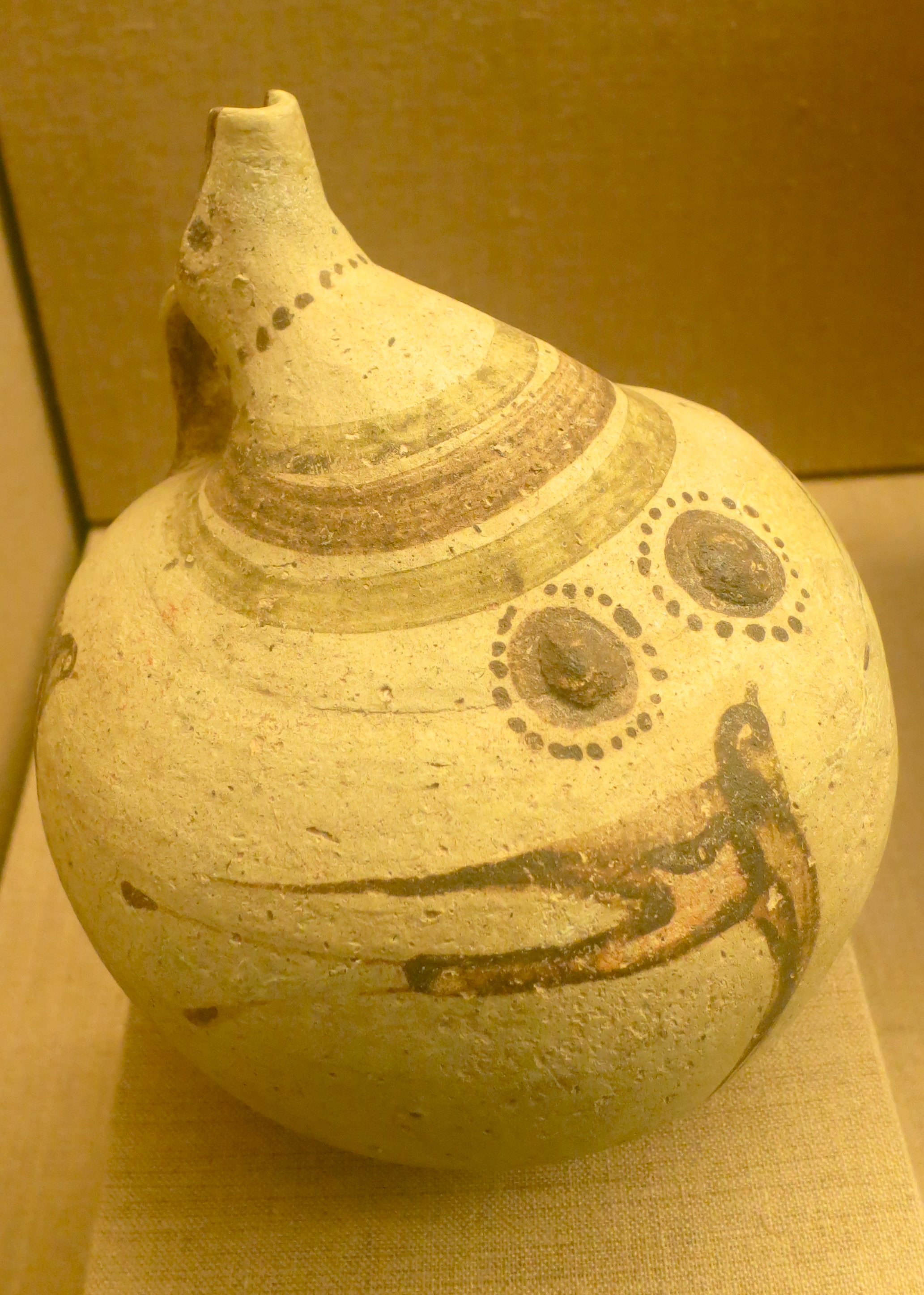 Another nipple ewer. This one featured a swallow. Both wild and domestic animals were featured prominently on Akrotiri artifacts. The yellow color, BTW, is because of the lights used by the museum to protect the ancient works of art.