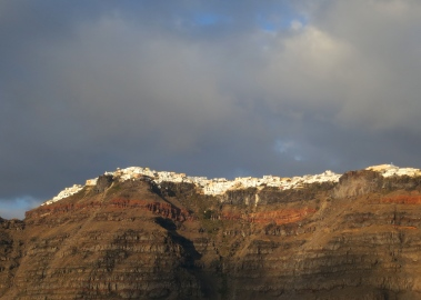 As we returned to our ship, which was anchored above the bulging lava chamber, we had a final look at the towering cliffs of Santorini and their beautiful white villages.