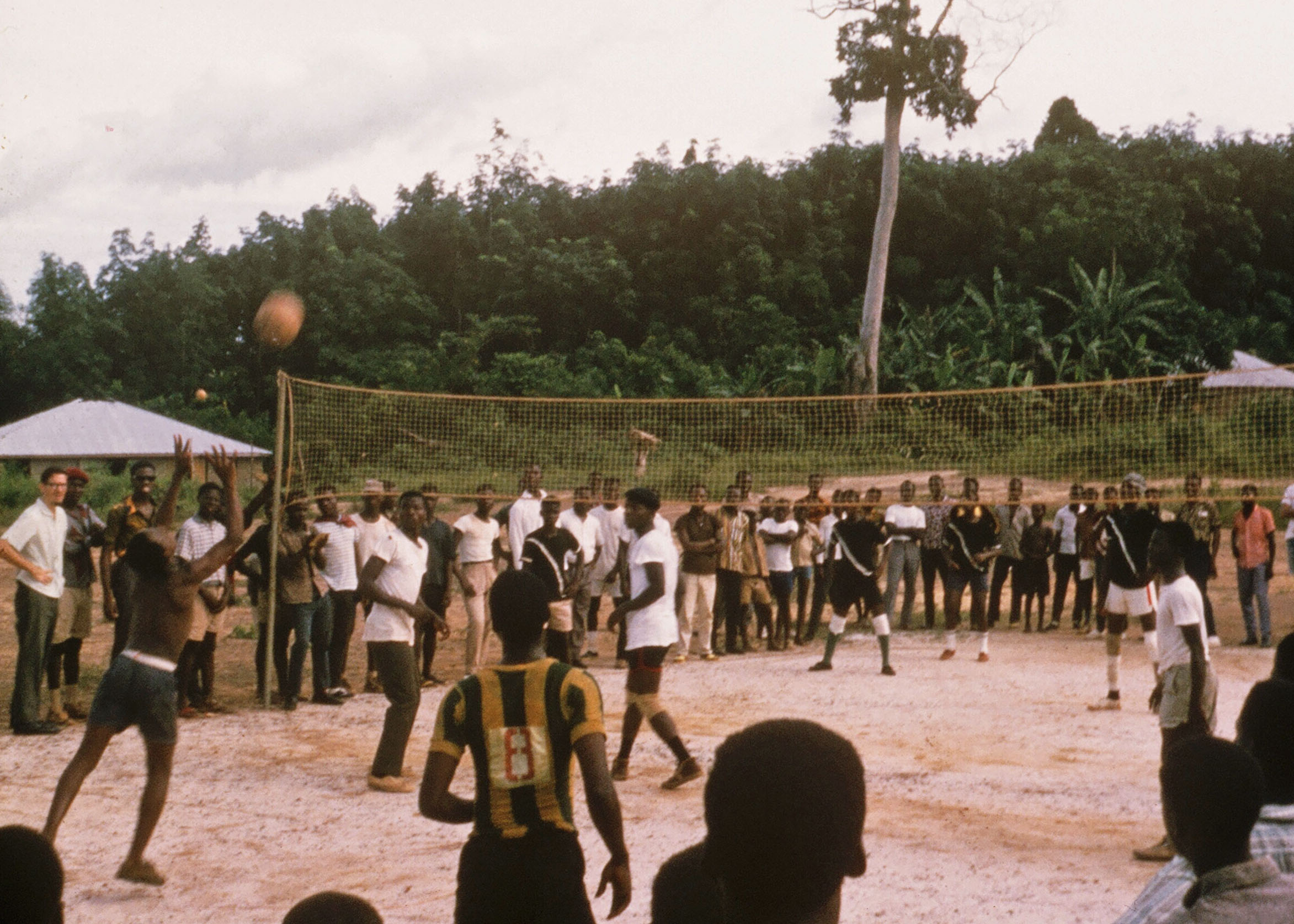 Good teaching involves capturing the imagination of students and encouraging them to become active participants in the classroom. Often it also involves participating in extracurricular activities. In this 1966 photo I am coaching Gboveh's High Scool volleyball team in Gbarnga, Liberia.