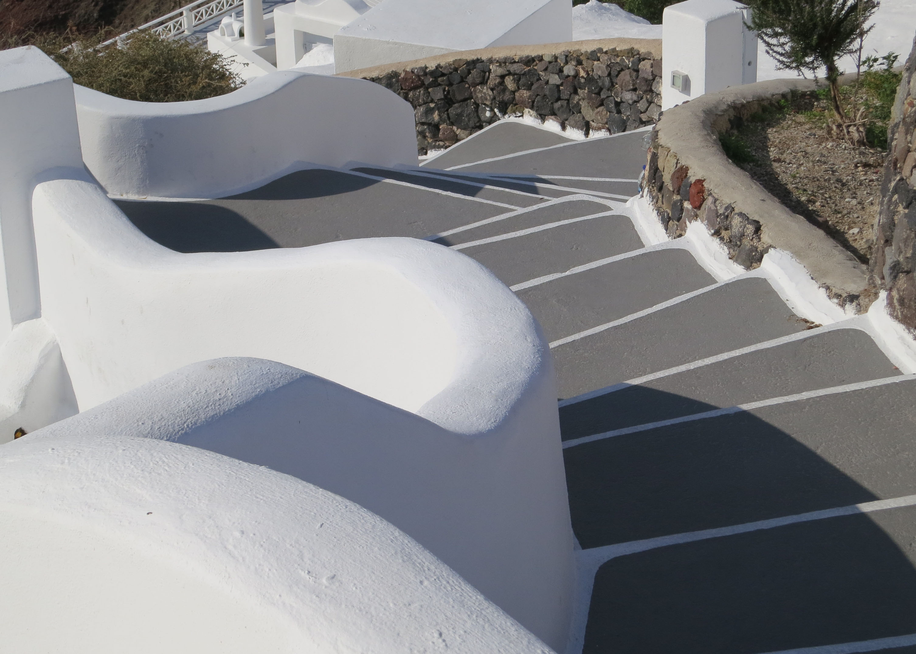 Stairways of all shapes and sizes went snaking down off the cliff in Oia, Santorini. This one was rather grand.