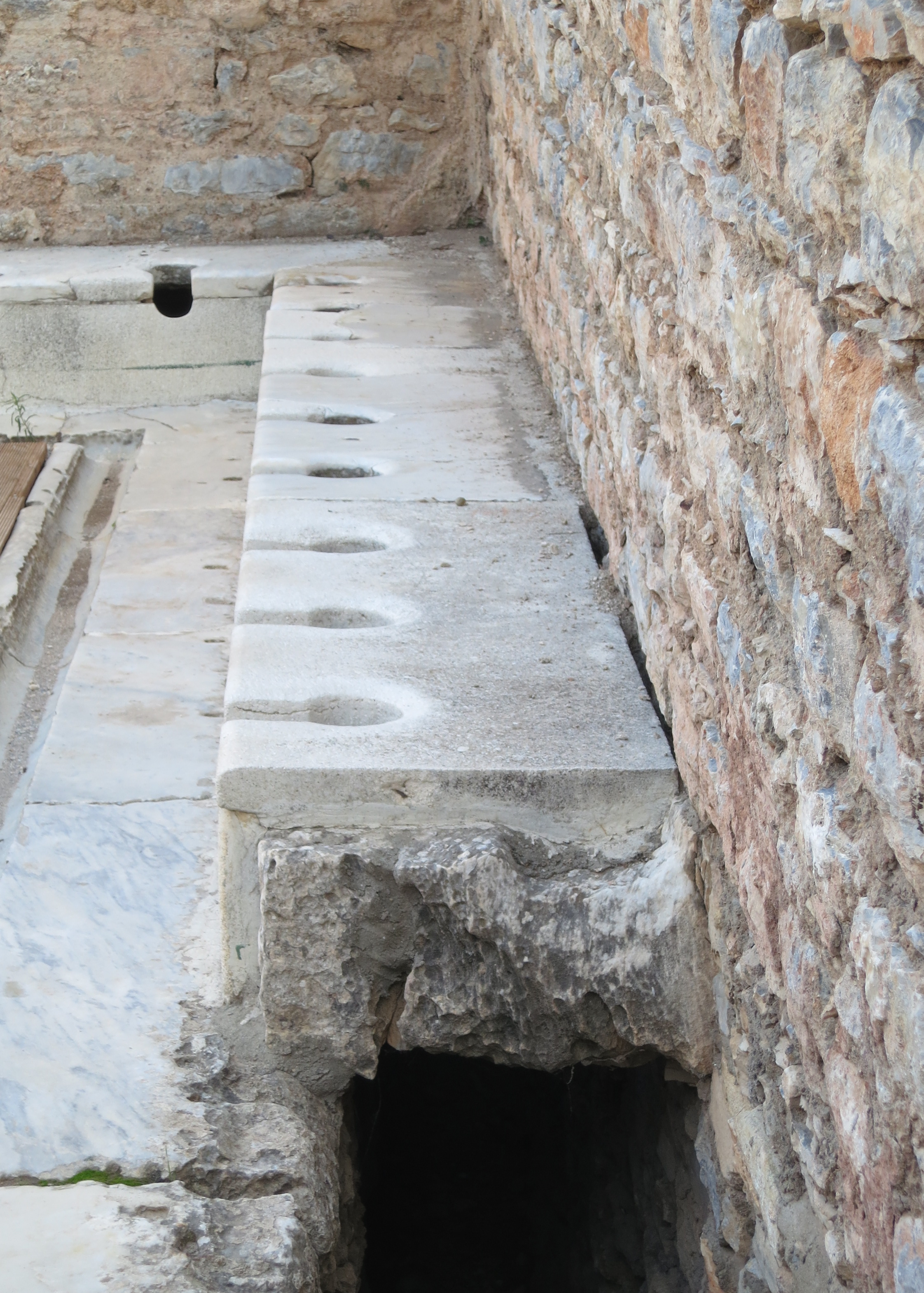 Unless you were wealthy in Ephesus, you used the common toilets shown here where you could line up with your friends and discuss the day's news while taking care of business. The men's toilet house could accommodate up to 40 people at once.