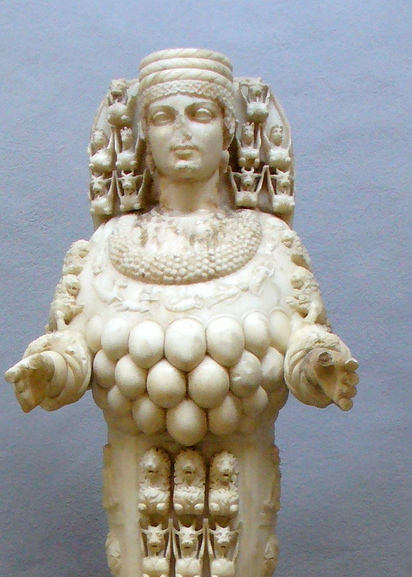 Artemis wearing her vest of Bull's testicles. Other statues suggest that the bulb-like objects are breasts.