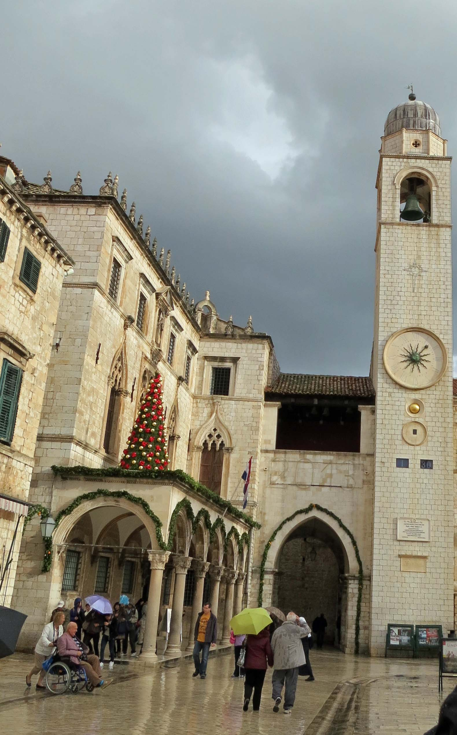 Another photo of Sponza Palace, the Christmas Tree and Dubrovnik's clock tower.