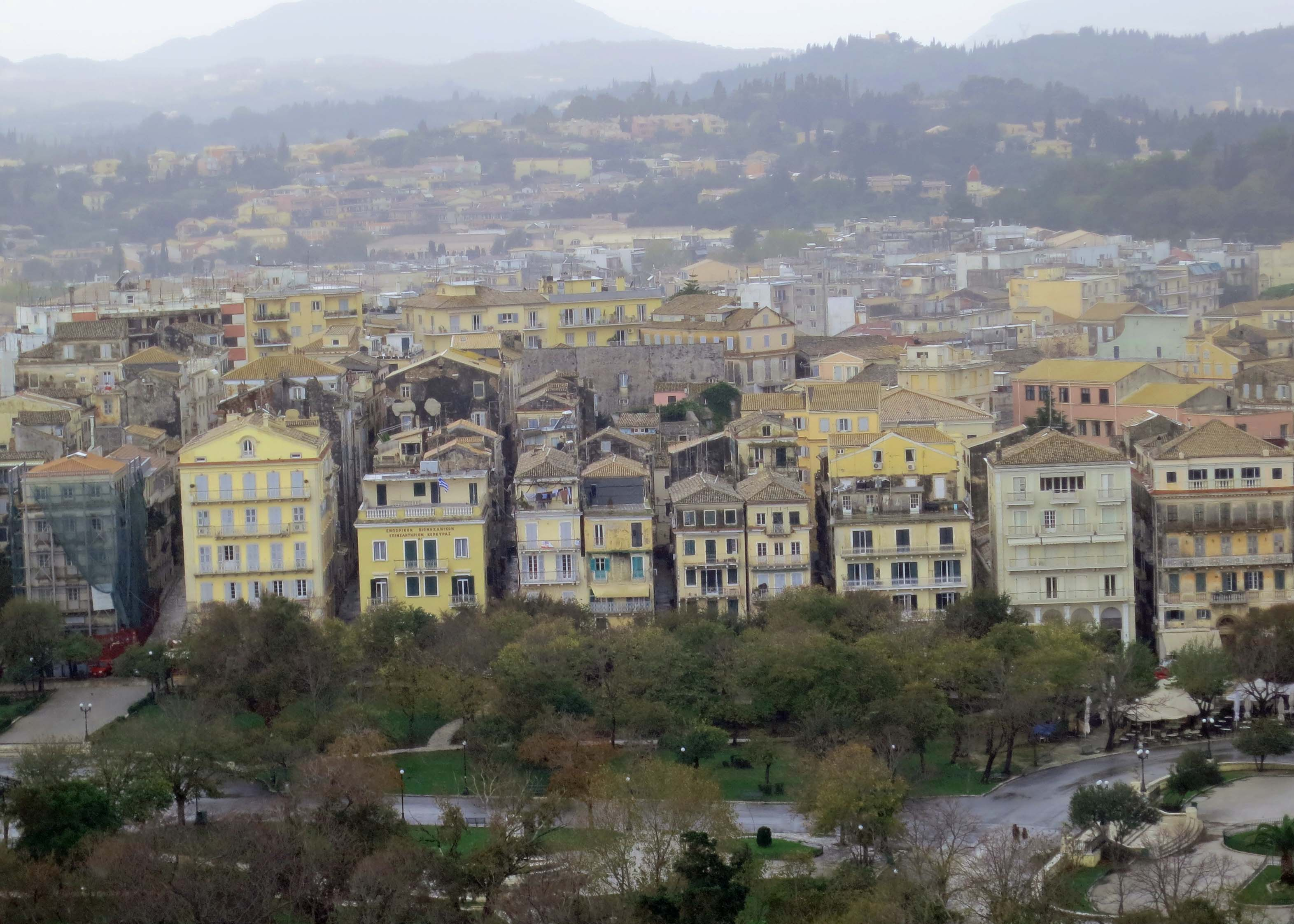 A view of Corfu with its multi-colored buildings and tree covered hills. I took this photo looking down from the Old Fort.