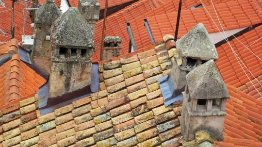 Another view of old and newer tiles in Dubrovnik. This one features chimneys.