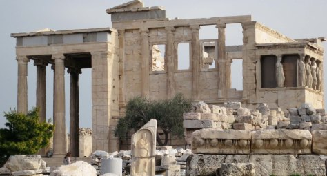 Another impressive building on the Acropolis is the Erechtheion. An olive tree decorates the front of the building.