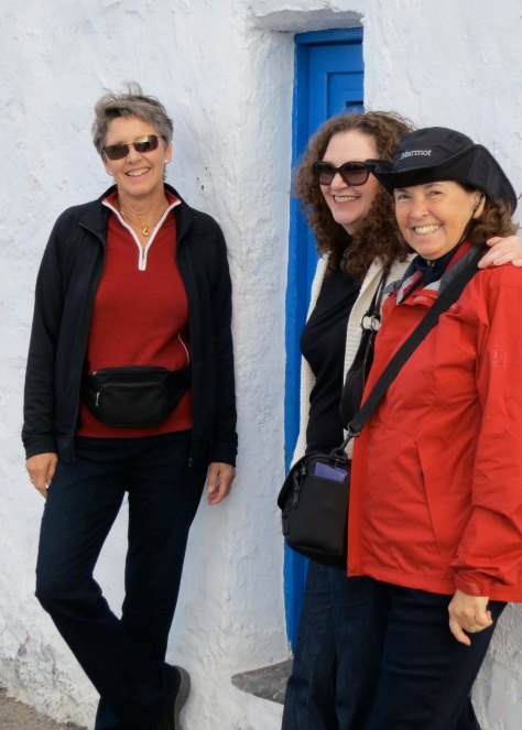 My wife Peggy on the right and two of our traveling companions, Kathi and Frances stand in front of another blue door.