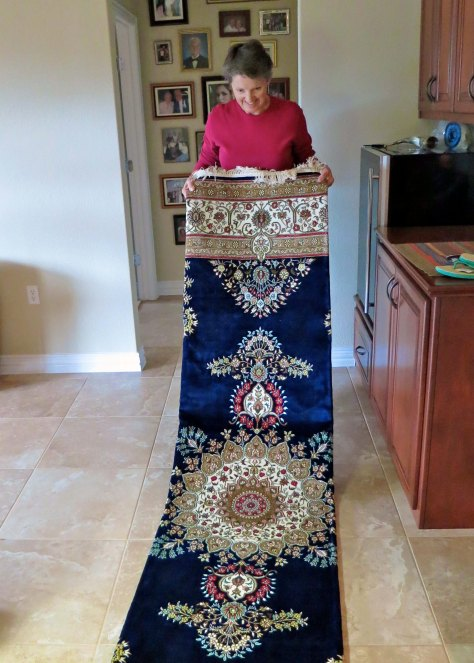 Francis unrolls John and her new silk carpet in their Texas home.