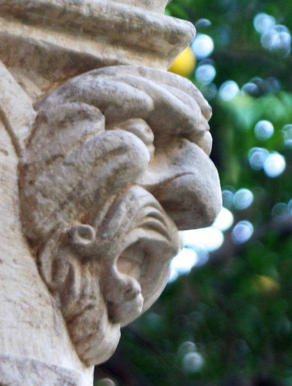 We found examples of grotesques in the cloister of the Franciscan Monastery of Dubrovnik on top of columns. (Photo by Peggy Mekemson)