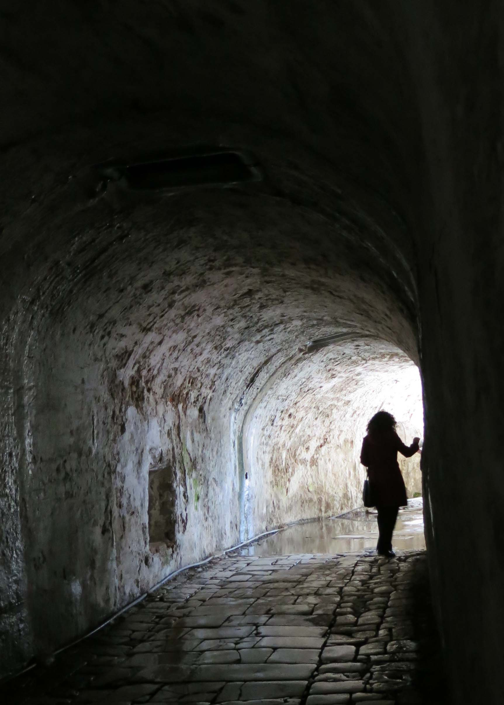 The most magical place for me in Corfu was the Old Fortress. Dating back to ancient times, the Venetians updated it in the Fourteenth Century. In this photo, Kathi Saage walks around a corner of one of the tunnels leading through the fort.