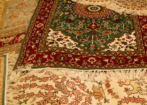 Dozens of Turkish rugs were scattered on the floor in Kusadasi, Turkey, thrown out in a frenzy of encouraging us to buy.
