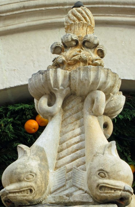 The top of Little Onofrio's Fountain with its ferocious looking fish. The fountain is located near the clock tower in Dubrovnik, Croatia.