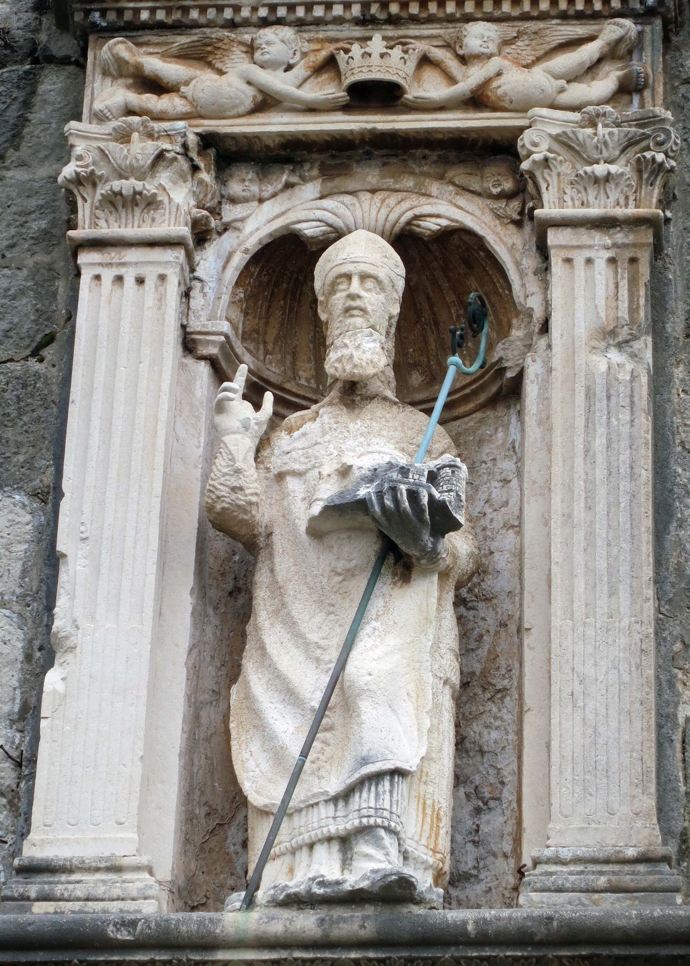 St. Blaise, the Patron Saint of Dubrovnik, holds a model of the city in his hand. This particular statue is found in the Pile Gate at one of the city's main entrances. (Photo by Peggy Mekemson)