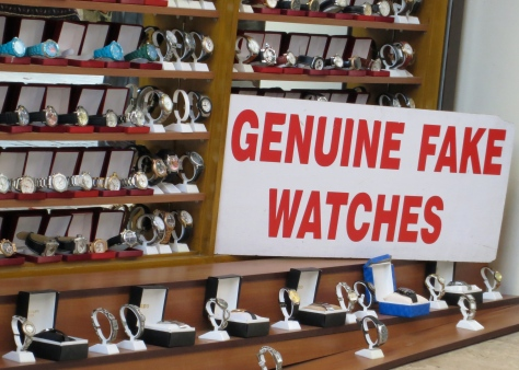 I was amused by this shop that offered genuinely fake watches... truth in advertising.