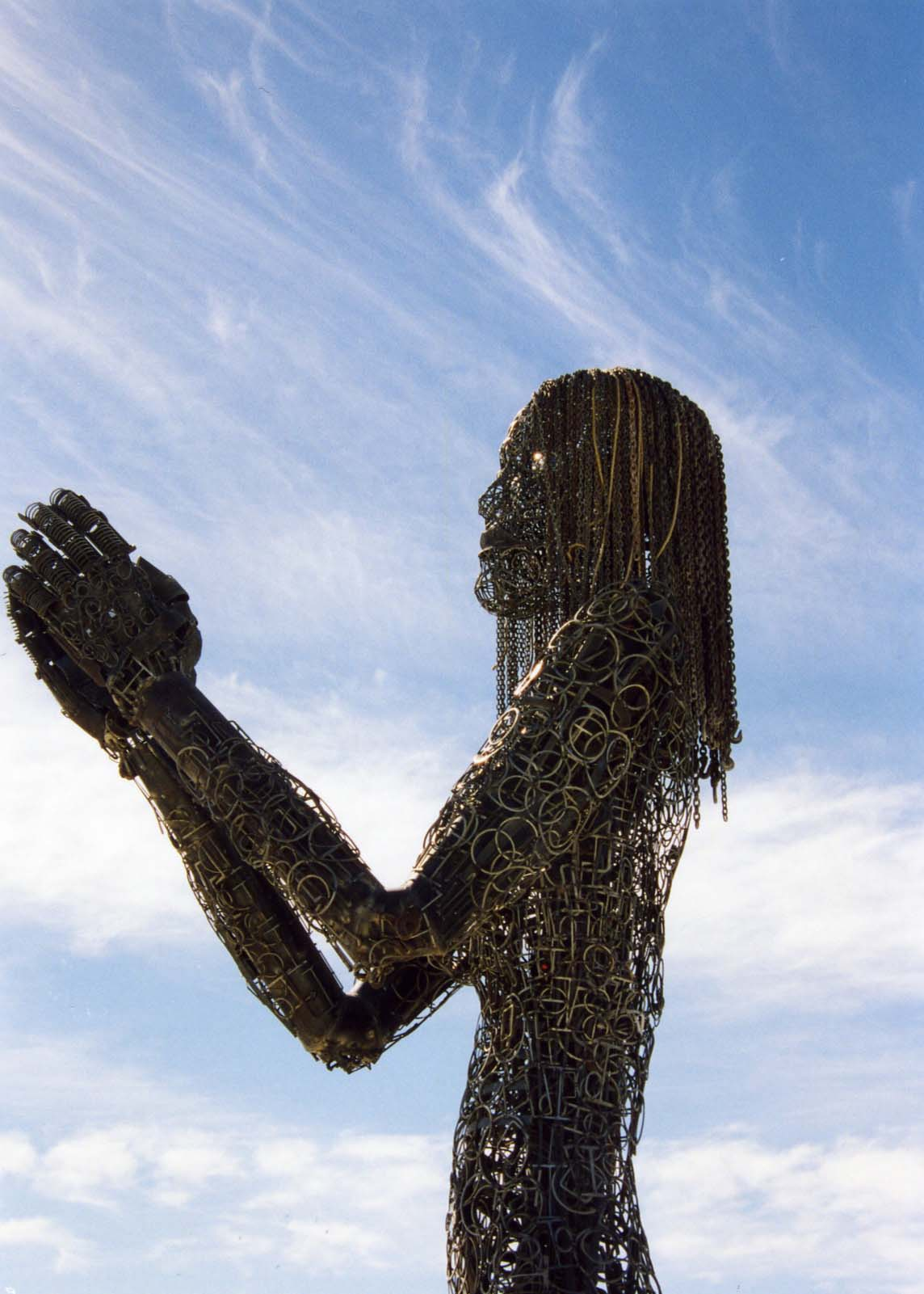 Hundreds of works of art are displayed annually at Burning Man. This woman, who was kneeling, stood at least 15 feet tall.