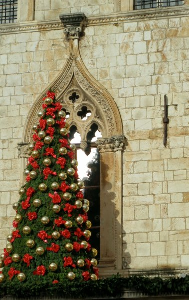 We visited Dubrovnik in December and found the city preparing for the holidays. In this picture,a Christmas tree is gracefully outlined by a window in Sponza Palace, the old custom house.