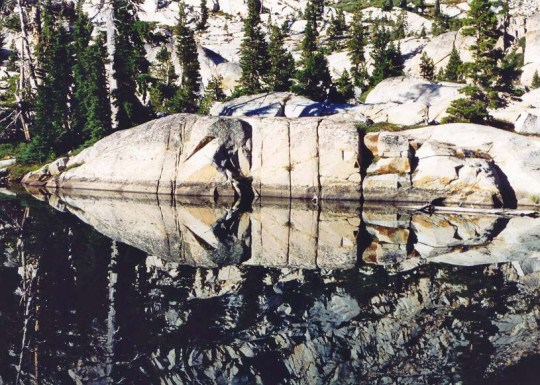 There are always delightful surprises waiting for you when you wander. I took this photo of Four Q lakes in the Desolation Wilderness near Lake Tahoe for its reflection. Only after the photo was processed did I see the mask.