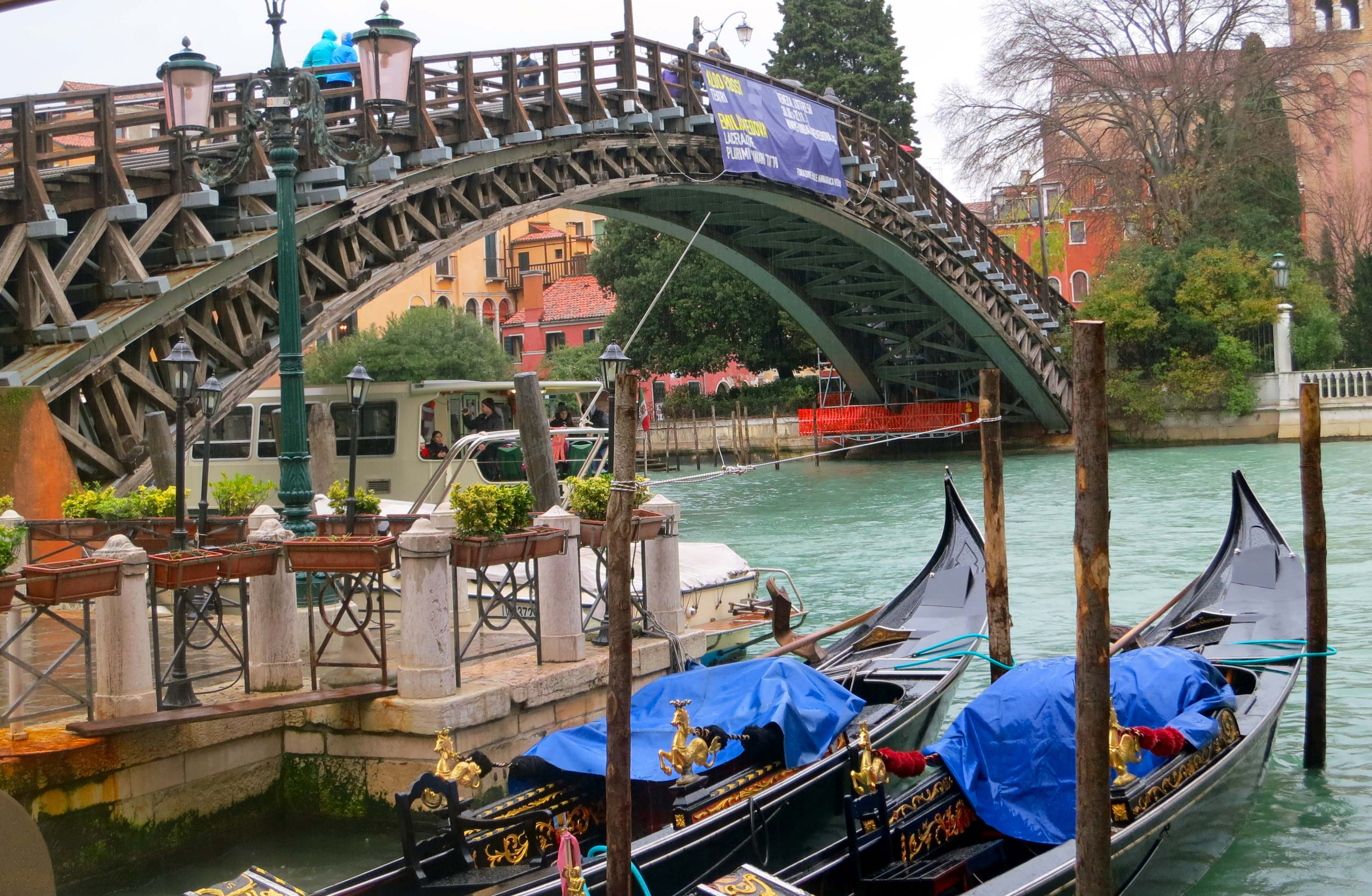 I took this photo from the other side of the Accademia Bridge to capture the parked gondolas and the boat taxi that is crossing under the bridge.