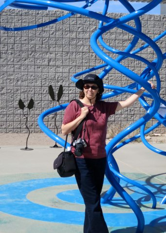 Peggy is standing next to a sculpture resenting air.