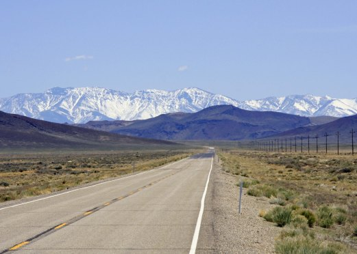 A common view in Nevada of empty roads and distant vistas, which are often quite scenic.