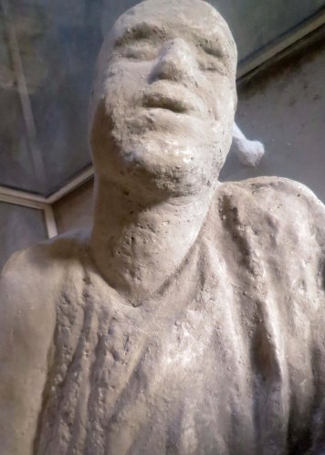 This body cast from Pompeii suggests to me that the person was gasping for breath.