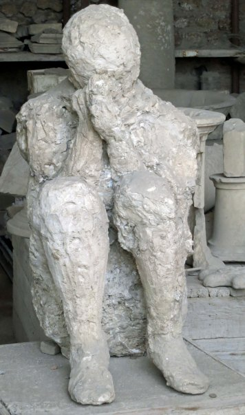 Plaster cast of body buried under pyroclastic flow of volcanic rock in Pompeii.