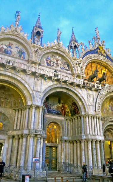 An evening view of the colorful St. Marks Basilica in Venice. The bronze horses on the upper right were stolen from Constantinople during the Fourth Crusade when Venice was supposed to be helping Constantinople, not plundering it.