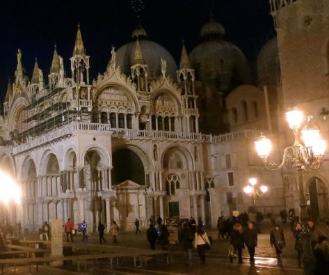 St. Mark's Basilica and street lamps by night.