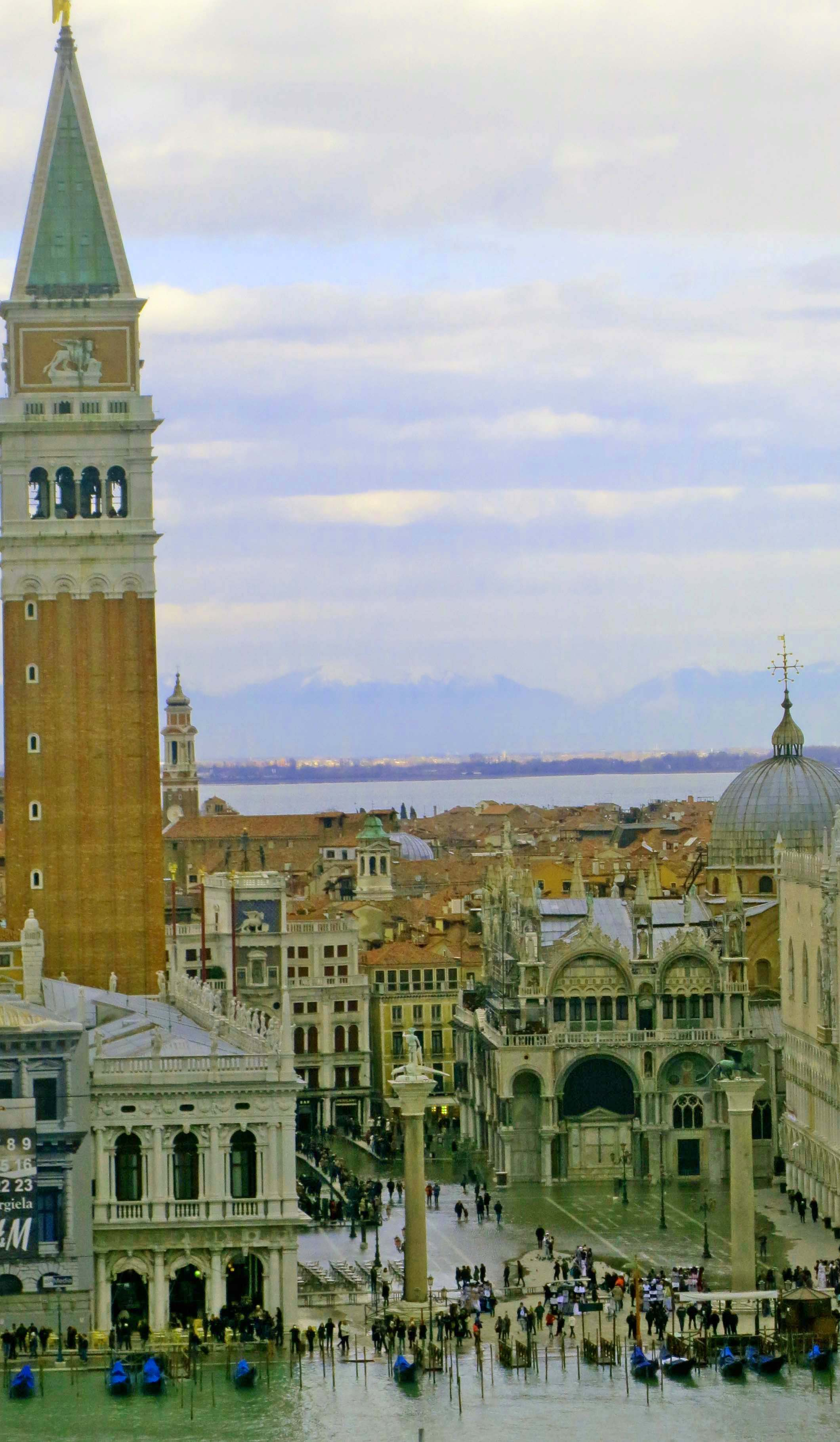 Looking down on St. Mark's Square. The Campanile is on the left, St. Mark's Basilica is on the right behind the Doges Palace.