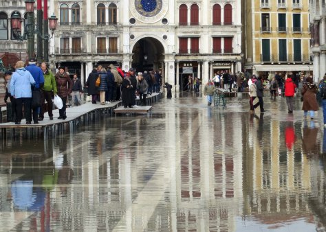 As I mentioned, Venice is subject to frequent floods. Global warming has added to this problem. This shot, taken just below the Clock Tower in St. Mark's Square, shows people using the table walkways and walking through the water.