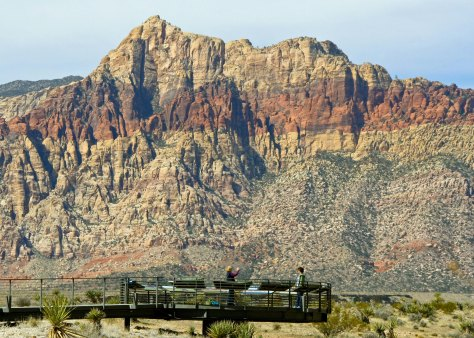 A view of the mountains and their distinctive ribbon of red from the Red Rock Canyon Visitors's Center.