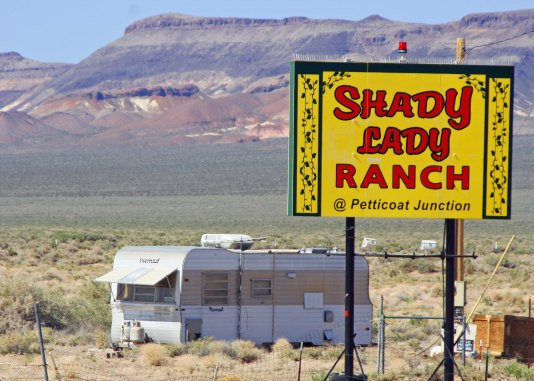 "Prostitution is still legal in Nevada and several ""cat houses"" are located along Highway 95."