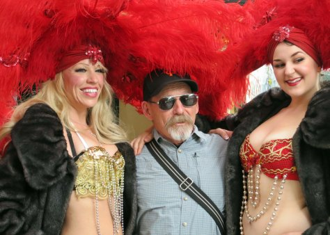 "My friend Ken Lake chose to pose with these ""show girls"" over Sponge Bob. It cost him a couple of bucks. I figured the least I could do was feature him in my blog."