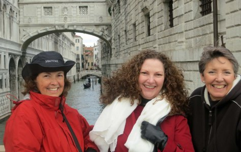 Peggy, Kathi Saage and Frances Dallen pose in front of the Bridge of Sighs. They aren't sighing but they are cold. A gondola lurks in the background. I suspect he was cold as well.