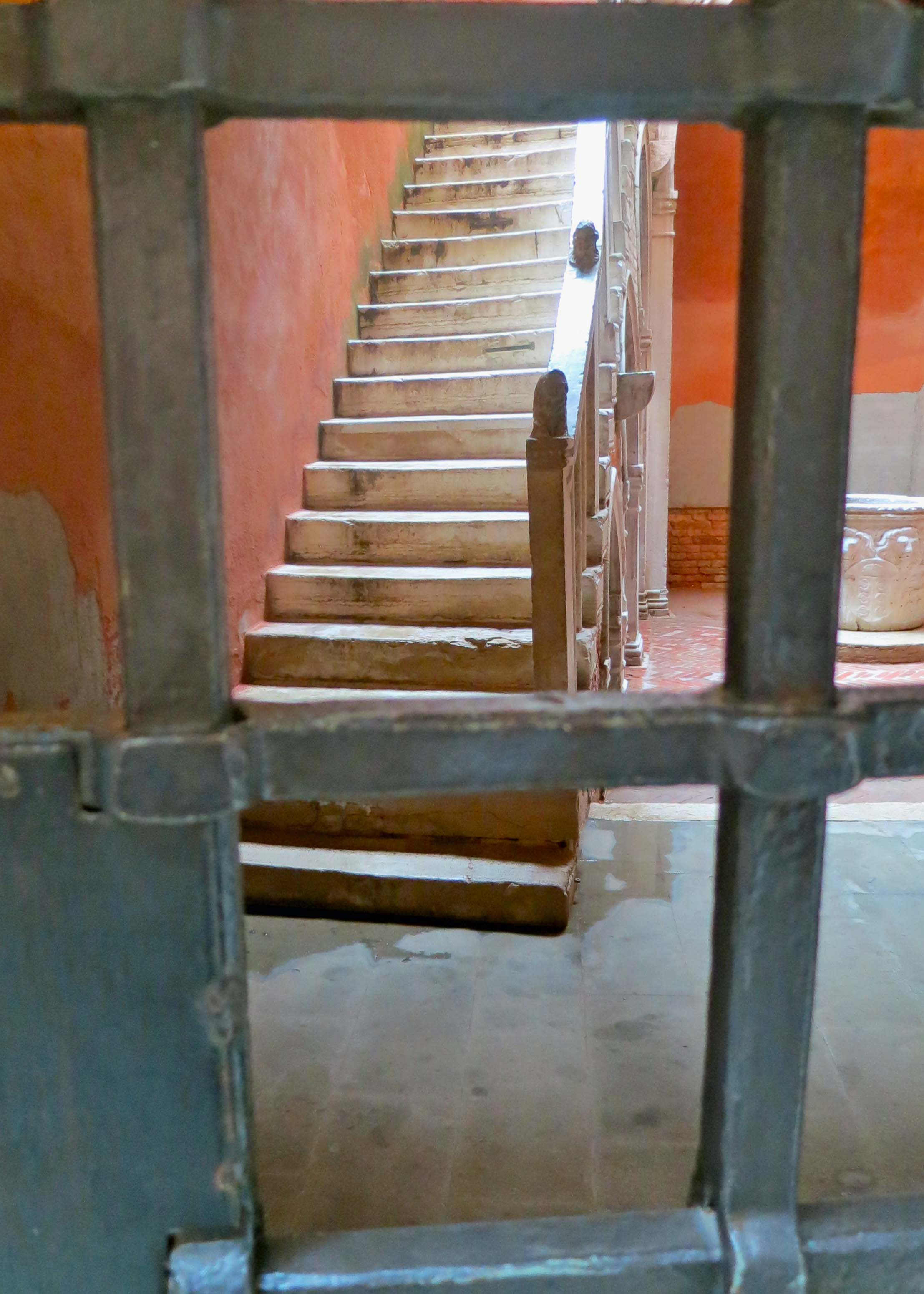 """I am always intrigued by what I consider as invitations, such as this stairwell in Venice. It's saying """"come and climb up. See what's up here."""" Unfortunately, the locked steel fence said something else."""