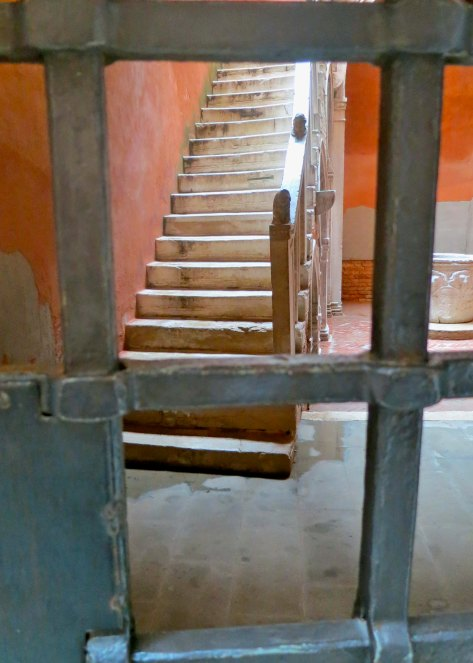 "I am always intrigued by what I consider as invitations, such as this stairwell in Venice. It's saying ""come and climb up. See what's up here."" Unfortunately, the locked steel fence said something else."