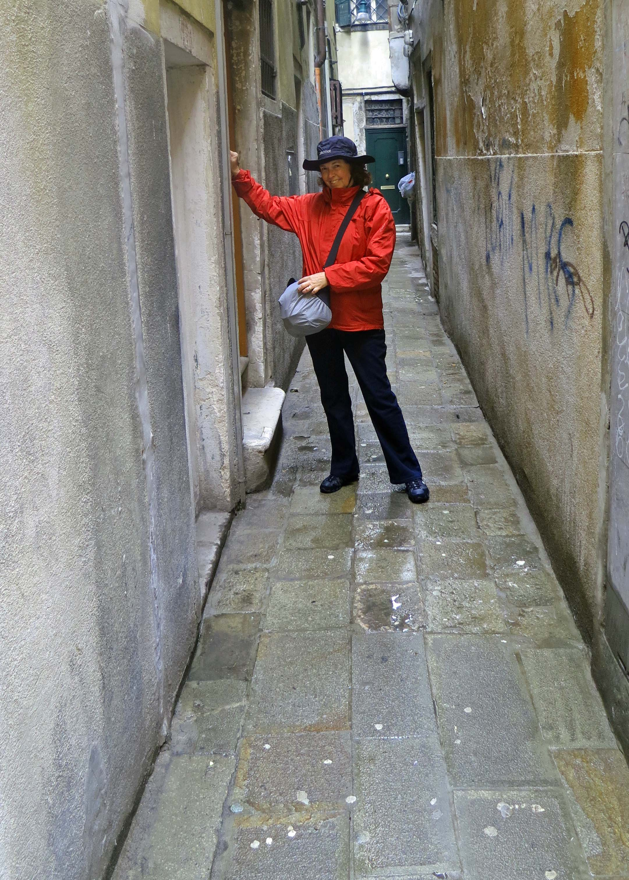Peggy Mekemson knocks on a door in the back streets of Venice.