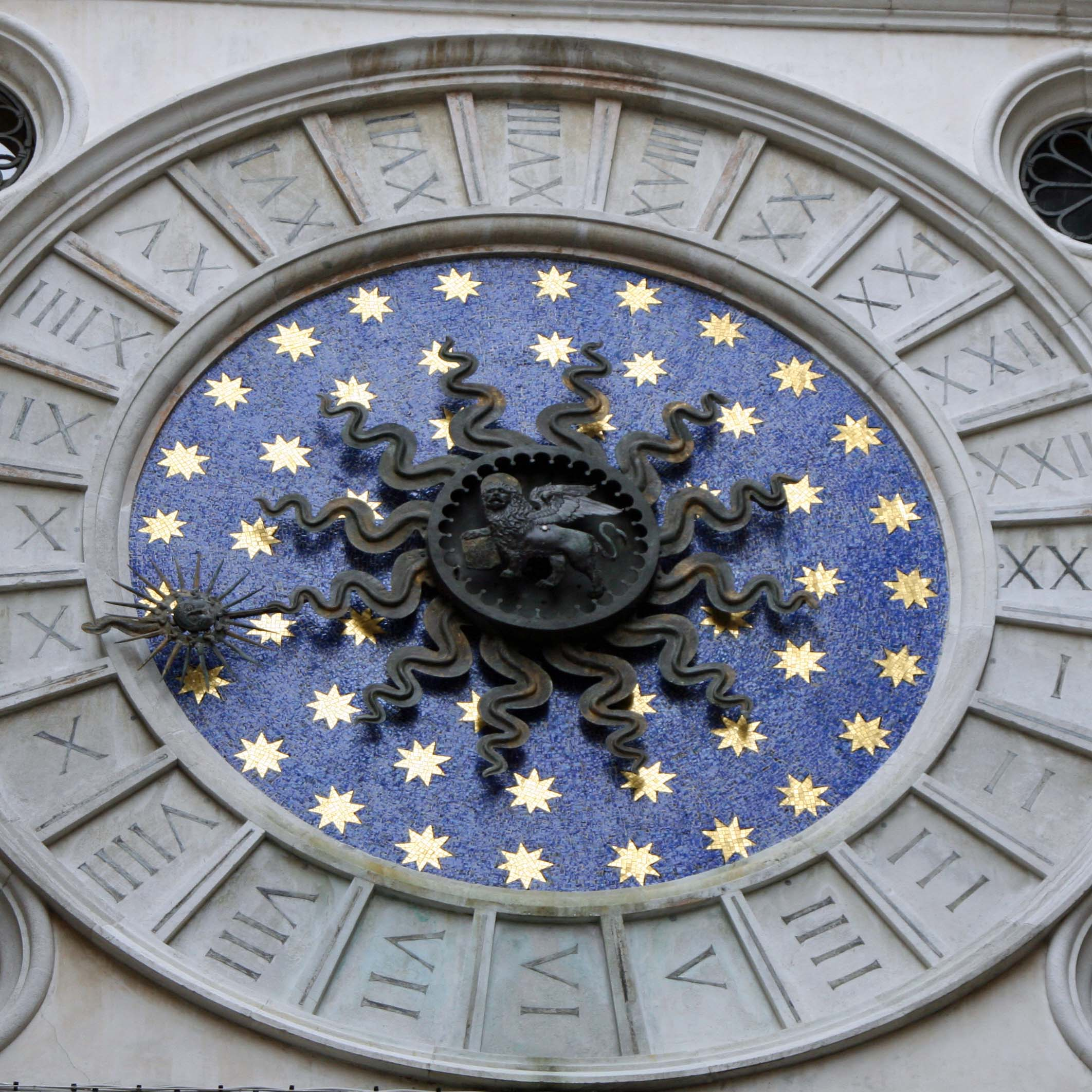 Starry roman numeral 24 hour clock found off of St. Marks Square in Venice Italy.