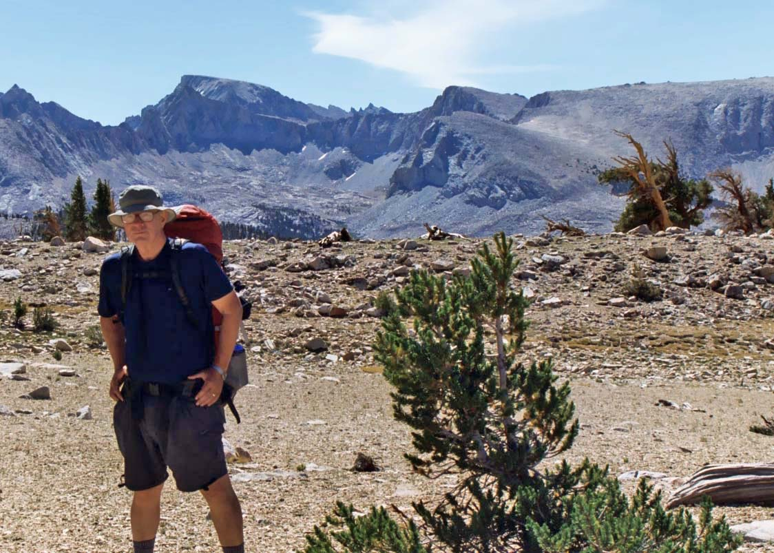 For my 60th Birthday, I chose to backpack 360 miles from Lake Tahoe to Mt. Whitney in California. Whitney is behind me in the photo.