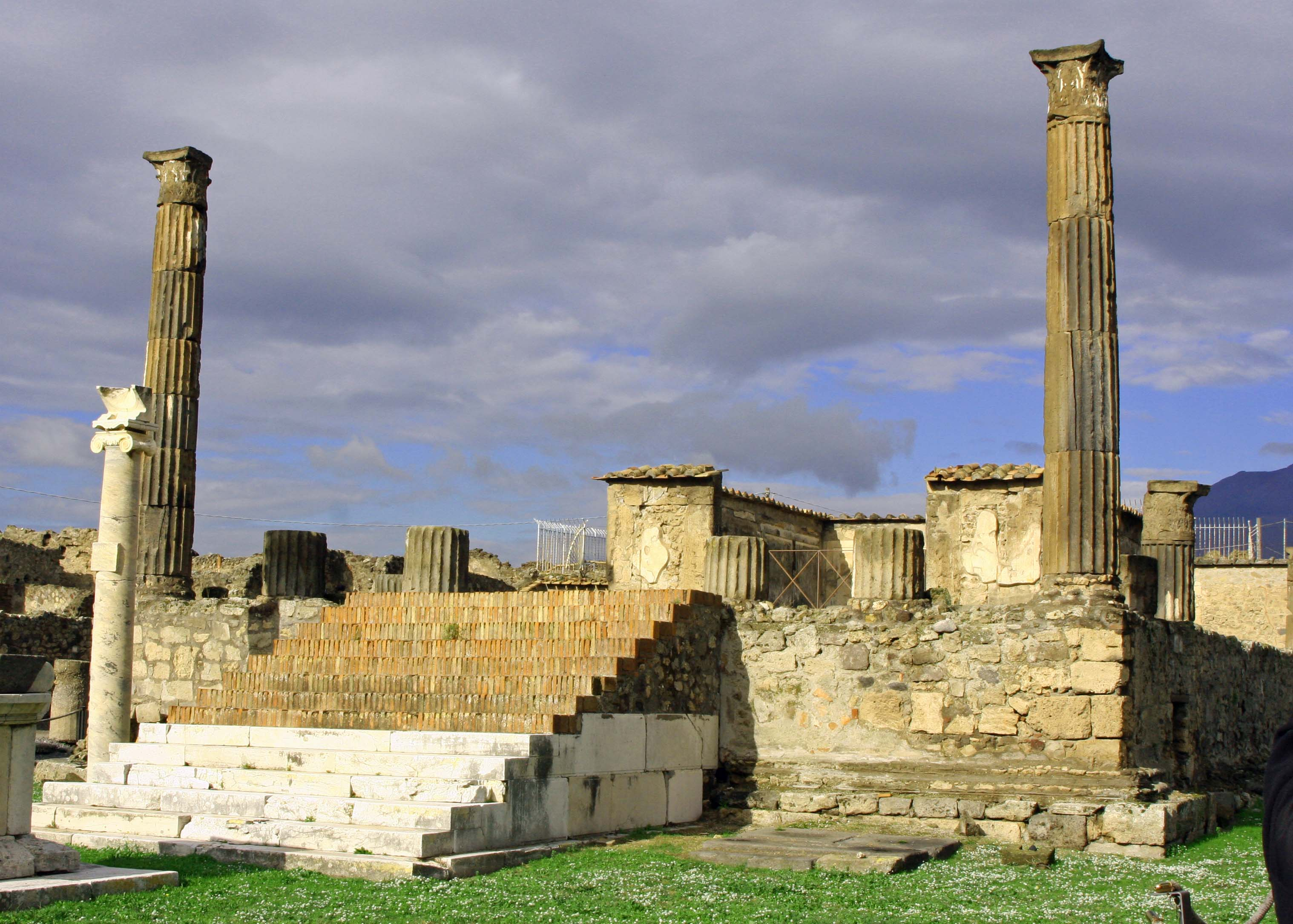 Dark clouds hover above Apollo's Temple caught in the sunlight. (Photo by Peggy Mekemson.)