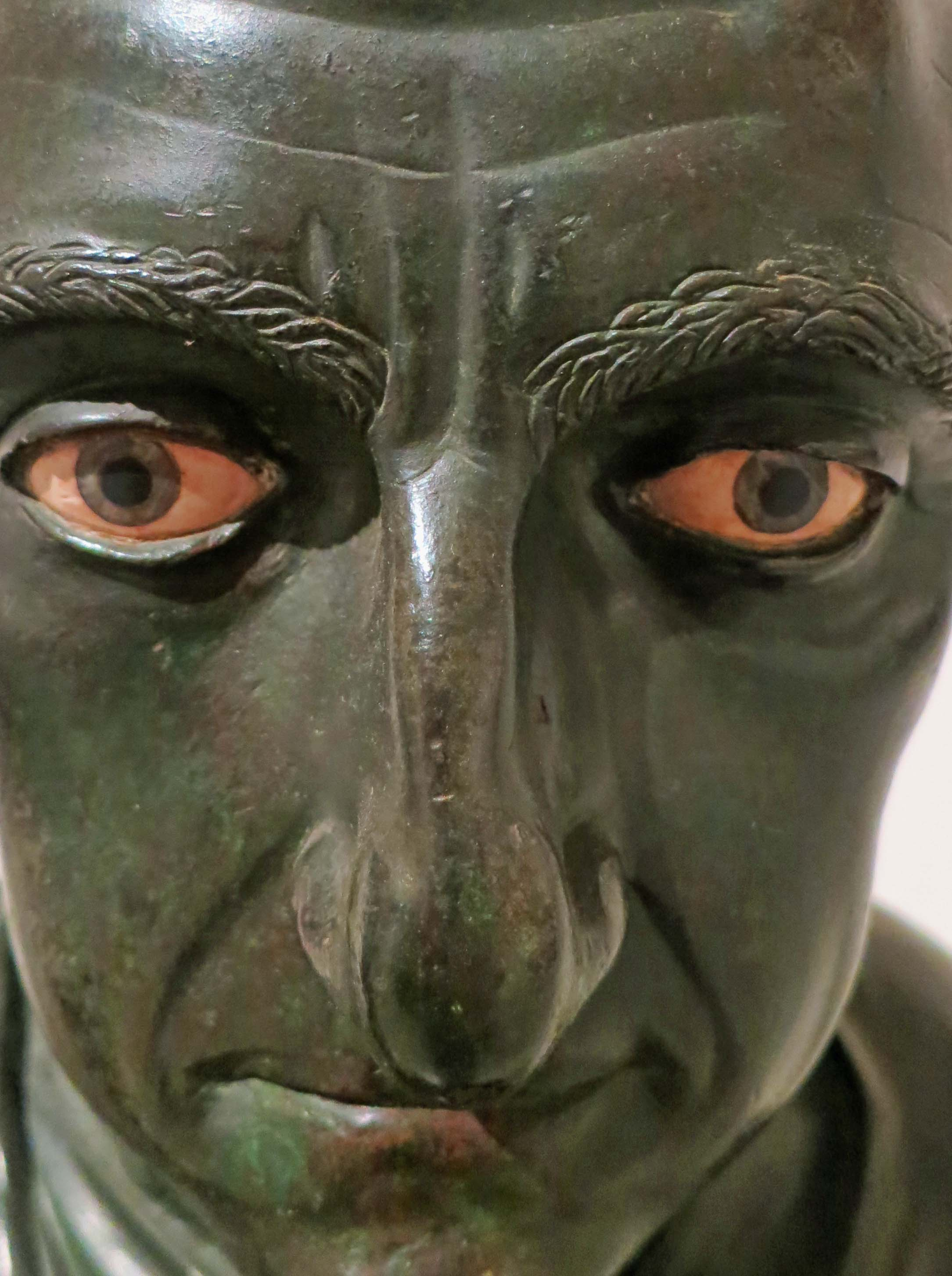 It is impossible not to feel the intensity of this face which tops a bronze statue recovered from the Herculaneum home of julius Caesar's father-in-law.