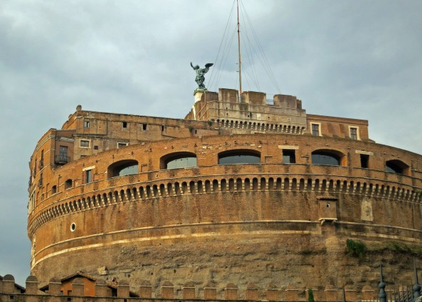 The rounded Castle St. Angelo stands next to the bridge. Built originally as a mausoleum for Emperor Hadrian, it would later become a prison and then fort. Today it serves as a museum.