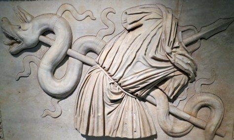 I found this bas-relief quite powerful but I will leave the interpretation up to you. For example, what about the spear intruding from the neck of the ghostly toga?
