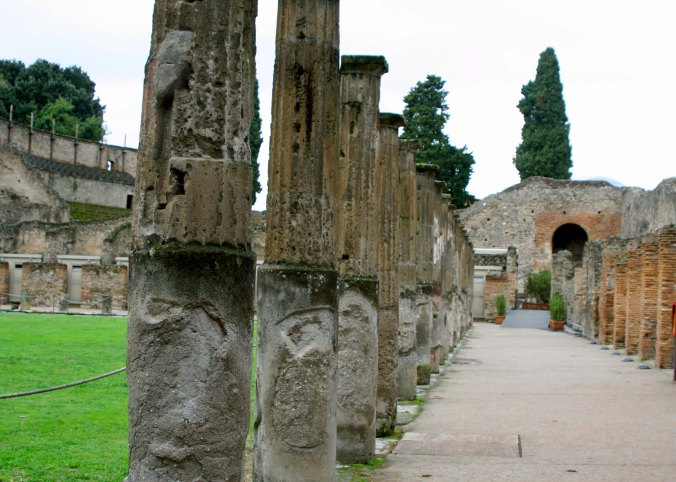 The clash of wooden weapons reverberated through the air as gladiators practiced on the field at the left. The hundred or so gladiators who trained at pompeii were housed in rooms on the right.