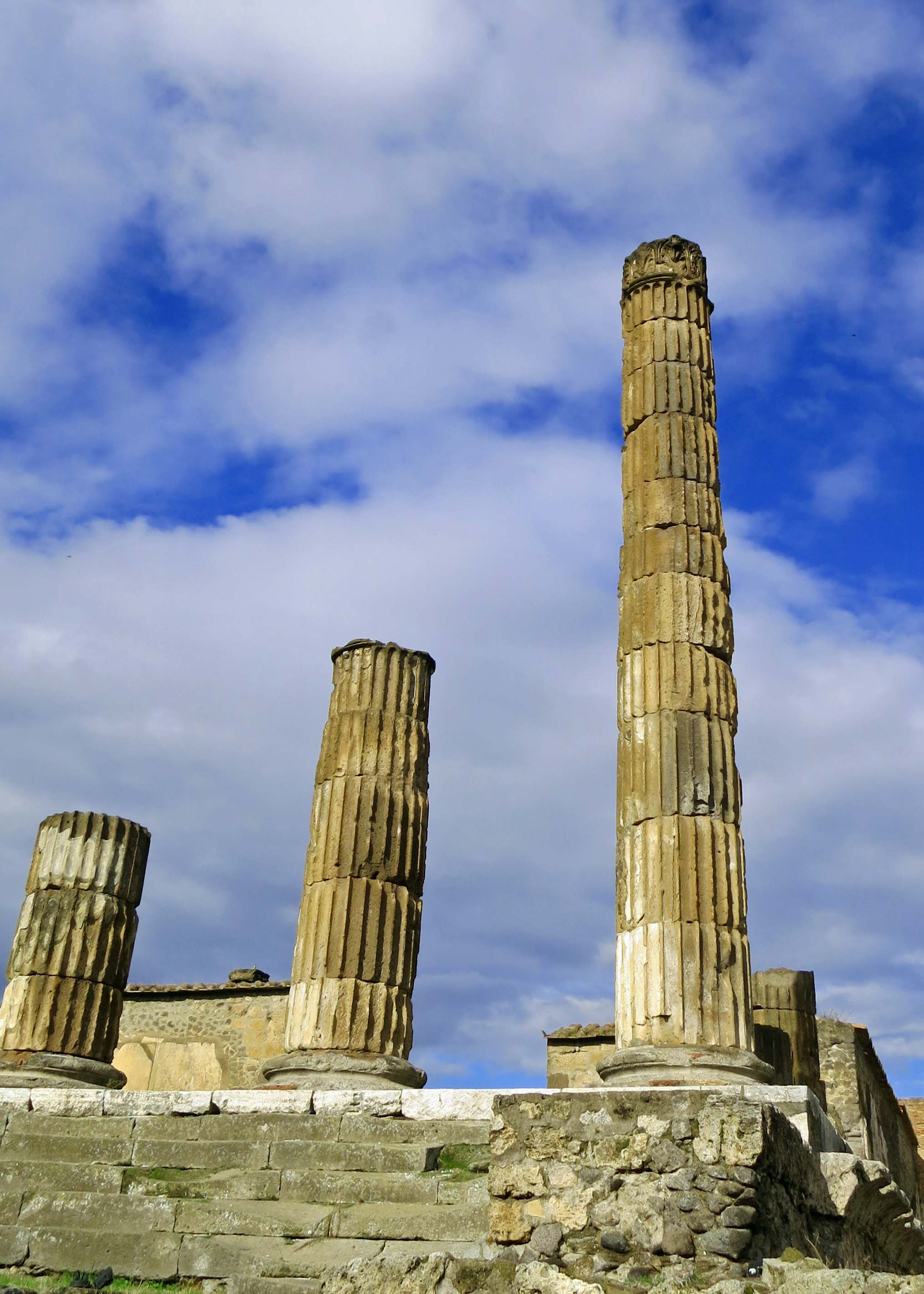 I liked this view of the Temple of Jupiter with it's stair step columns. A massive earthquake had destroyed the temple in 62 AD. It was still being rebuilt in 79 AD when covered by volcanic rock from Mt. Vesuvius.