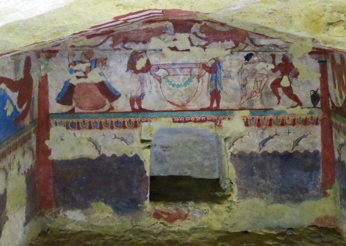 This photo is taken looking at the tomb of the Lions through the small window proved for visitors. Note the musicians, dancers and lions.